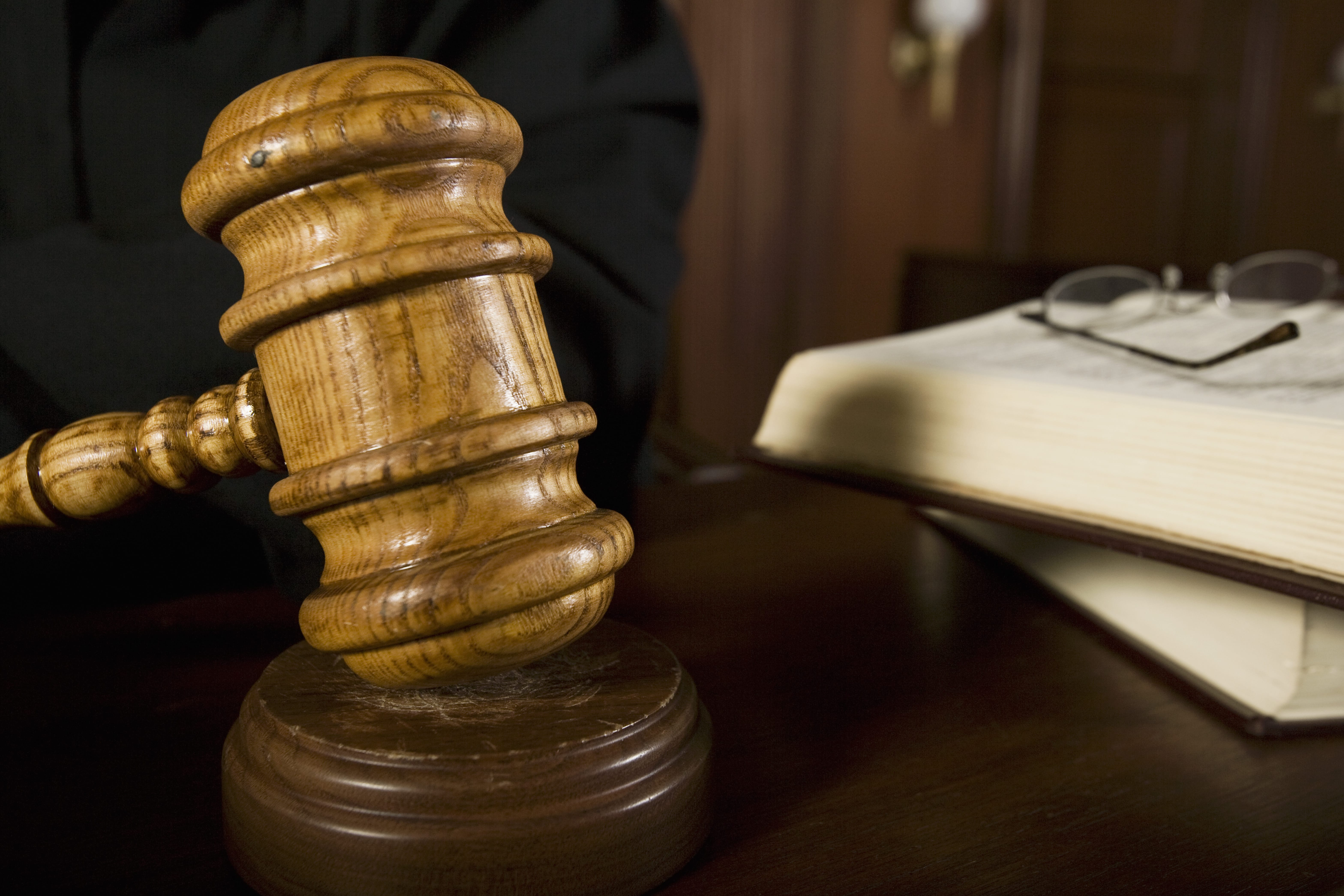 Judge using gavel in court, close-up